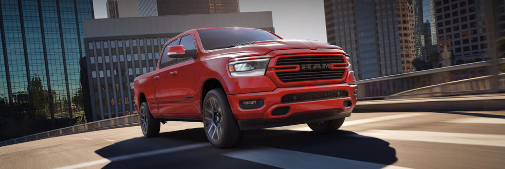 2018 Ram 1500 driving on a city street