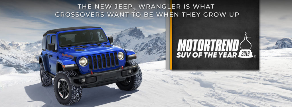 motortrend suv of the year graphic featuring blue jeep wrangler rubicon