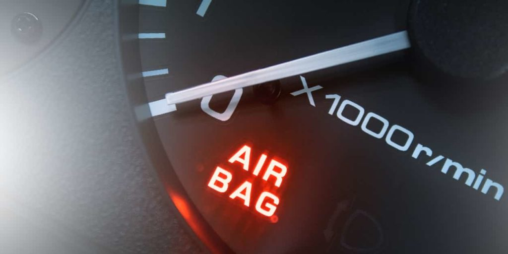 Vehicle odometer with the 'air bag' light on in bright red