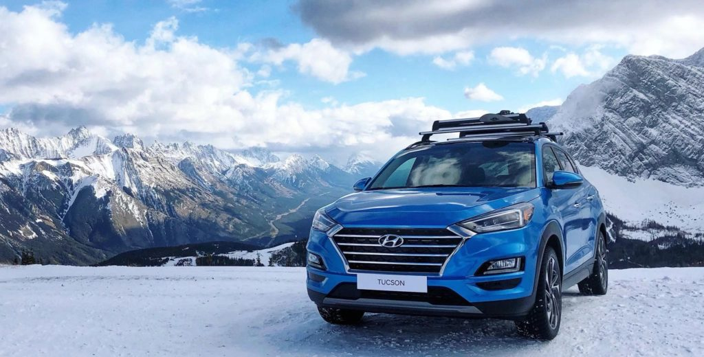 hyundai tucson on snowy mountain top
