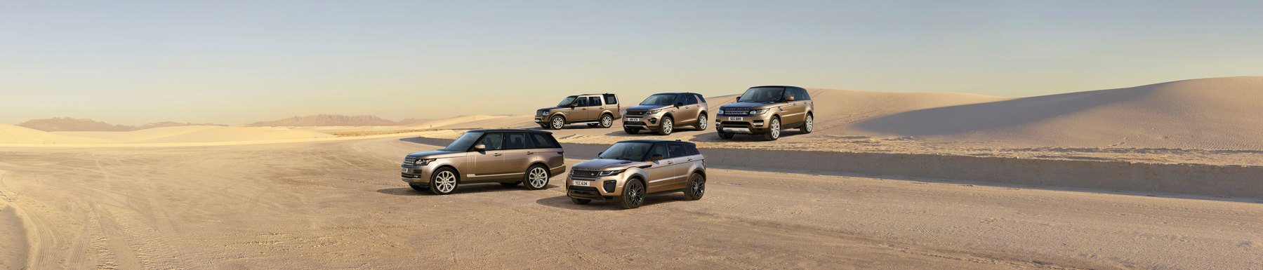 Land Rover Vehicles in desert Header Image