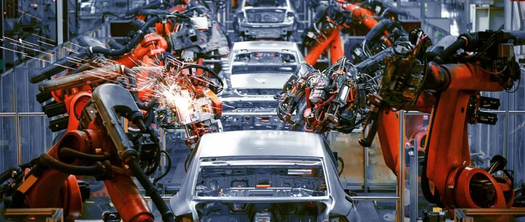 Robotic welders putting together a Honda vehicle