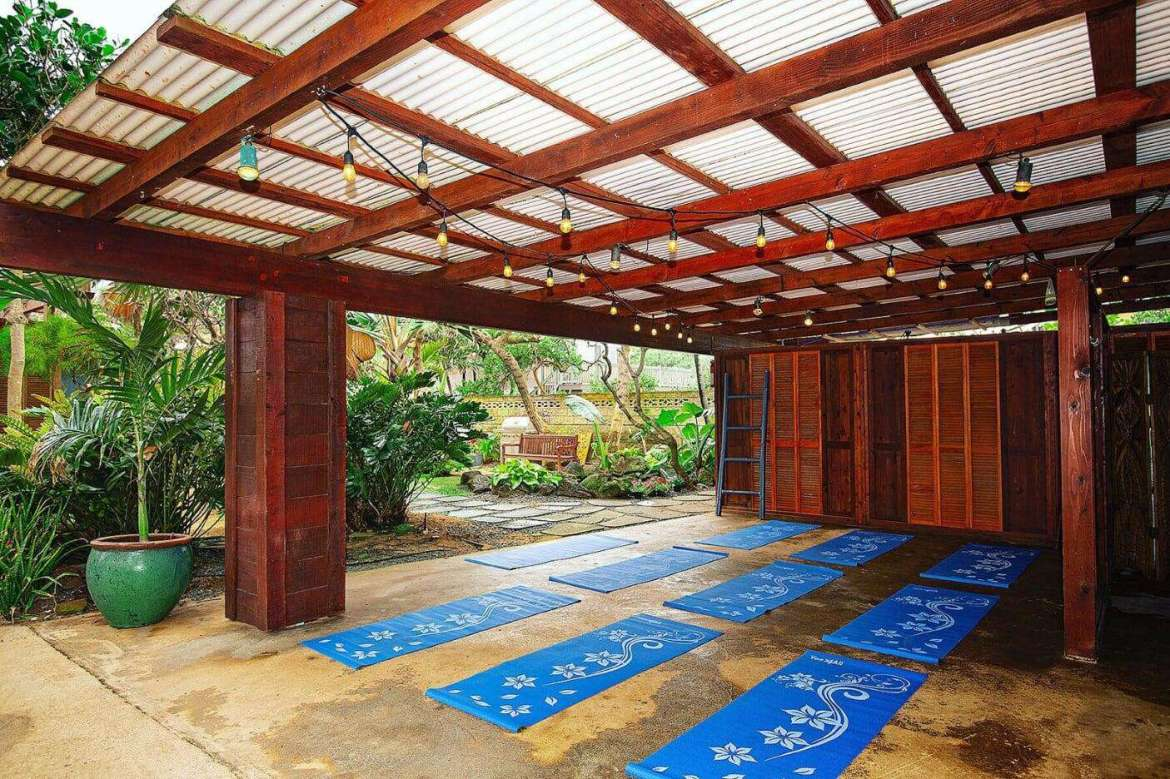 Patio common space can be arranged for many functions including a yoga space.