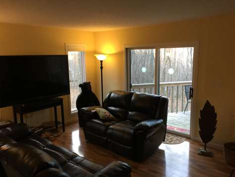 Another view of living room, tv, 2 sliding glass doors to deck