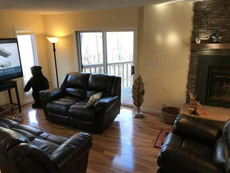 View of living room, fireplace, tv, deck - all leather recliners