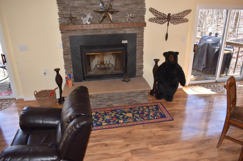 Wood-burning fireplace between tv and dining