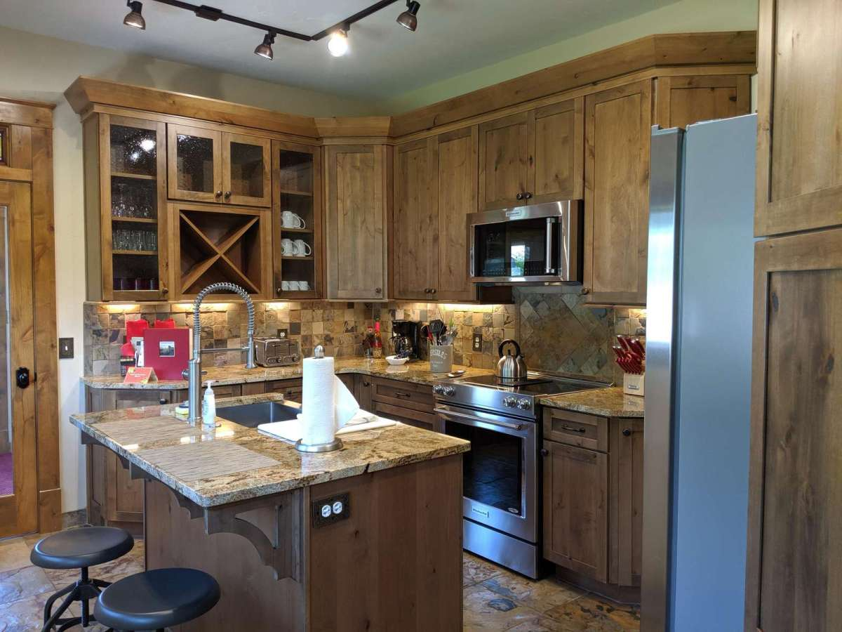 Kitchen has all stainless steel appliances with a lot of space