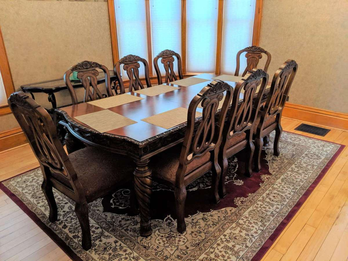 Large formal dining room with 8 seat seating