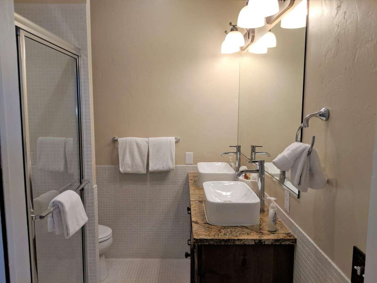 Newly updated bathroom offers an extra large walk in shower and double sinks