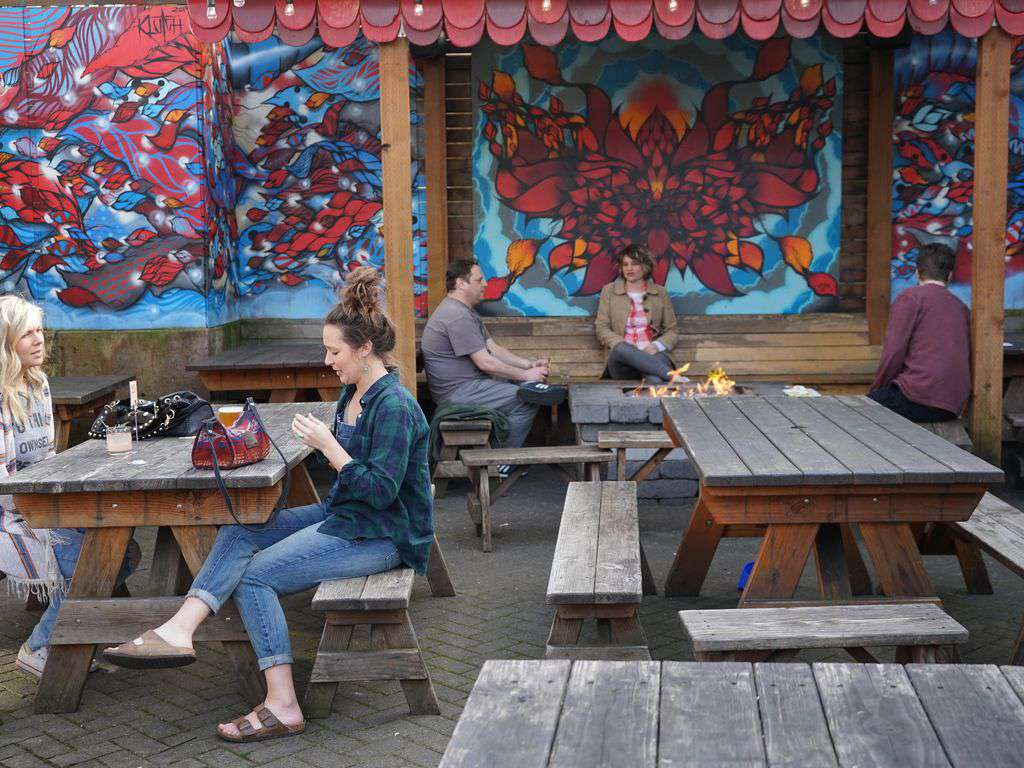 Lots of bars with hip patios to visit.