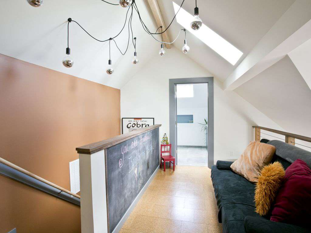 Upper loft area with futon bed and chalkboard wall for drawing time!