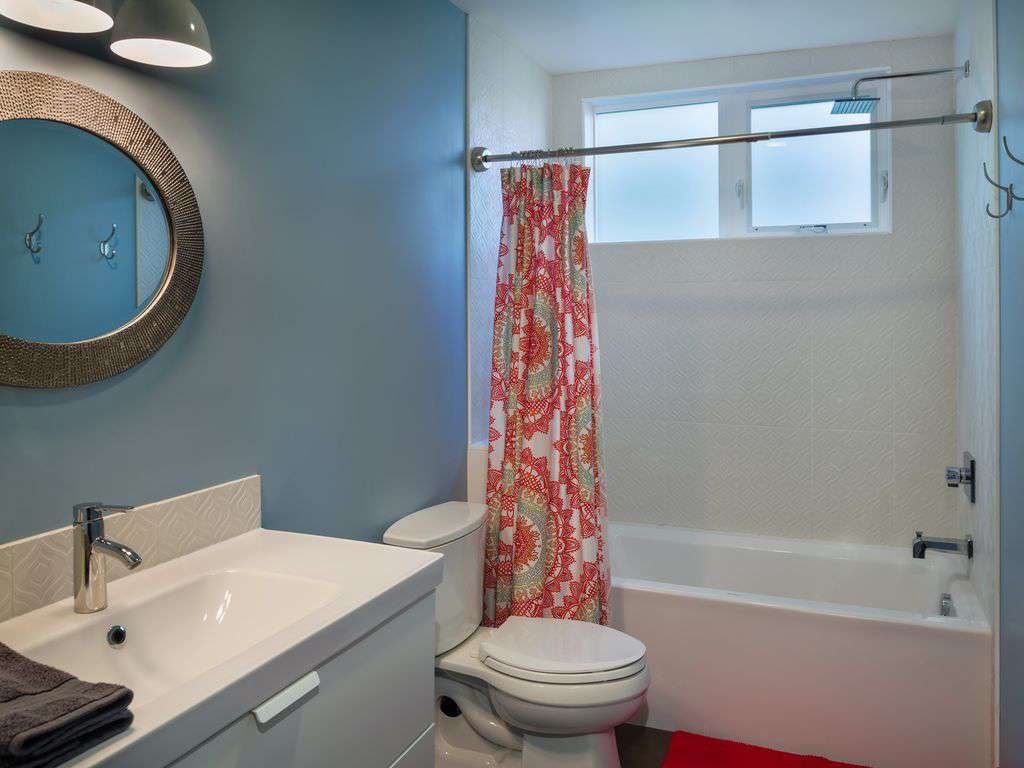 1 of 3 full bathrooms, with tub for kids, and rain head shower too!