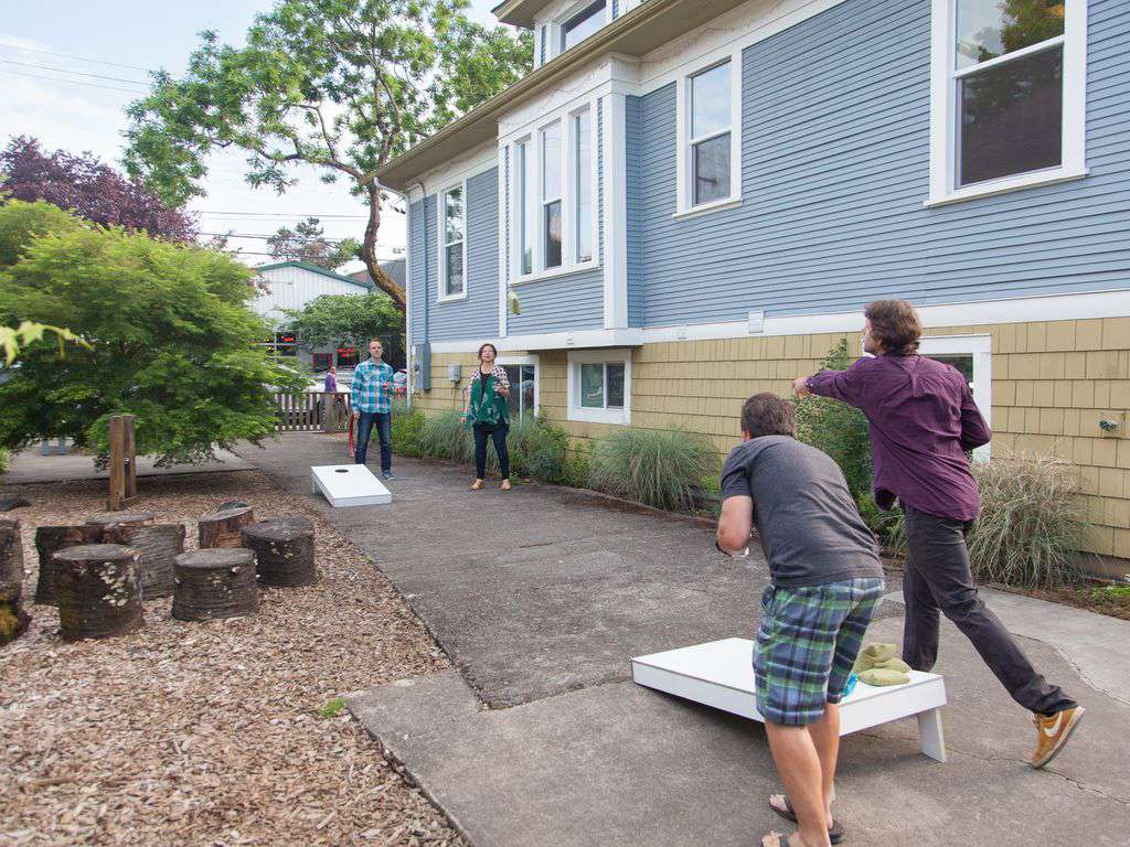 The side yard is shared with the upper rental and has corn hole, & other games