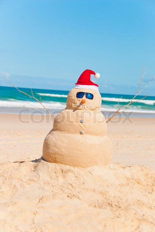 Snowman Made Out Of Sand With Ocean In Background Sandman
