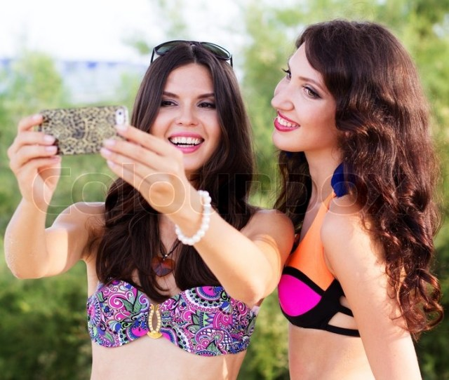 Two Pretty Sexy Girls Friends Are Taking Selfe Pictures Together At The Beach Stock Photo Colourbox