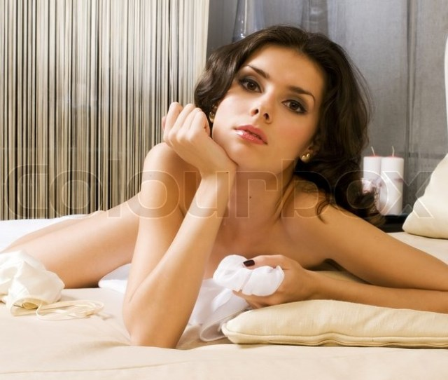 Portrait Of The Beautiful Naked Woman In A Bedroom Stock Photo Colourbox