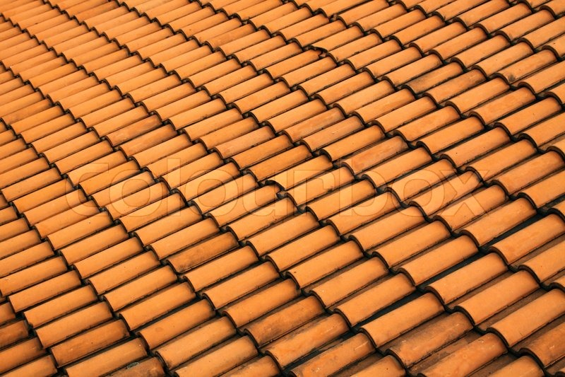 A Red Tile Roof With Repeating Patterns Stock Photo