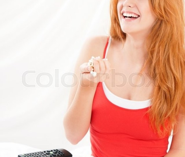 Young Beautiful Happy Girl Watching Movie Or Tv In Bed And Eating Popcorn Stock Photo Colourbox