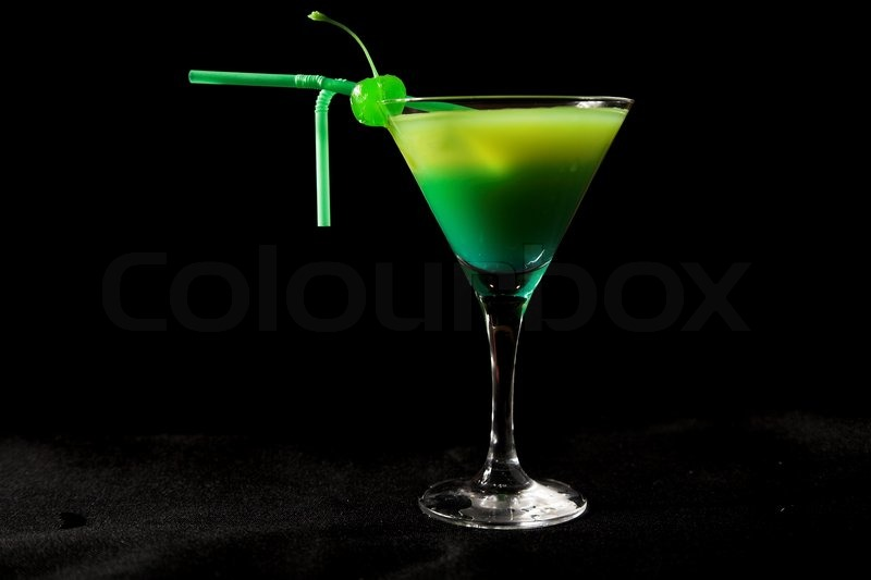 Green Cocktail With Cherry Isolated On Black Stock Photo