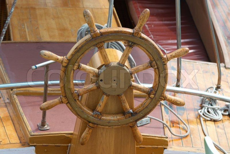 Old Wooden Steering Wheel On The Boat Stock Photo