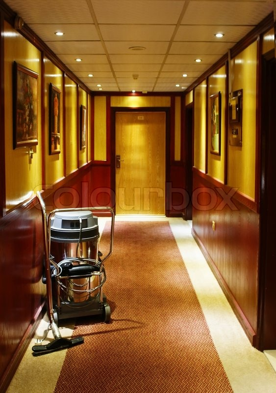 Vacuum Cleaner Stands In The Corridor Of The Hotel Stock