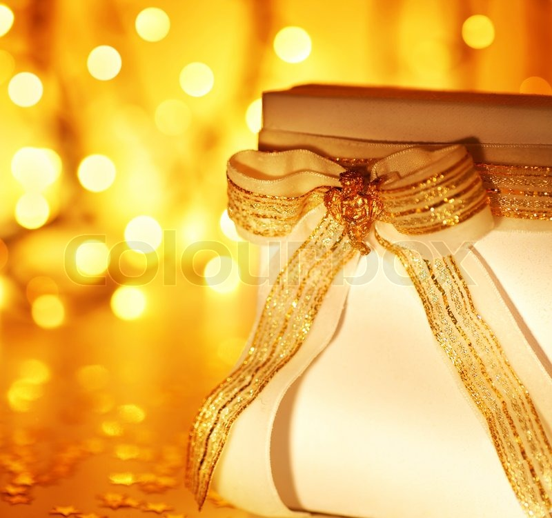 Gold Holiday Background With White Present Gift Box