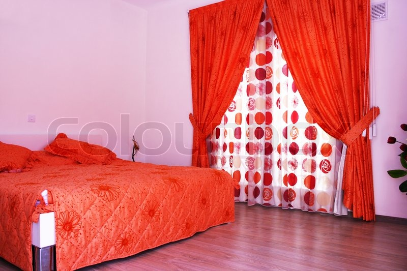 Bedroom With Pink Walls Red Curtains And Bedspread