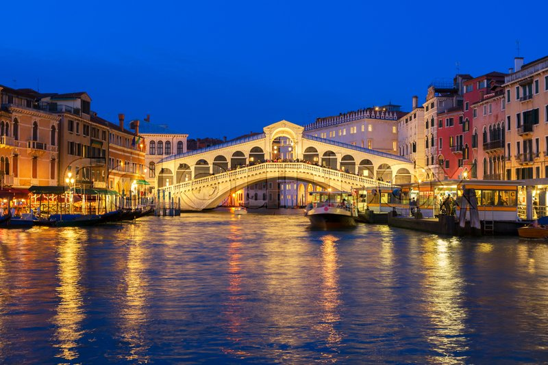 View Of Famouse Rialto Bridge At Night Stock Photo