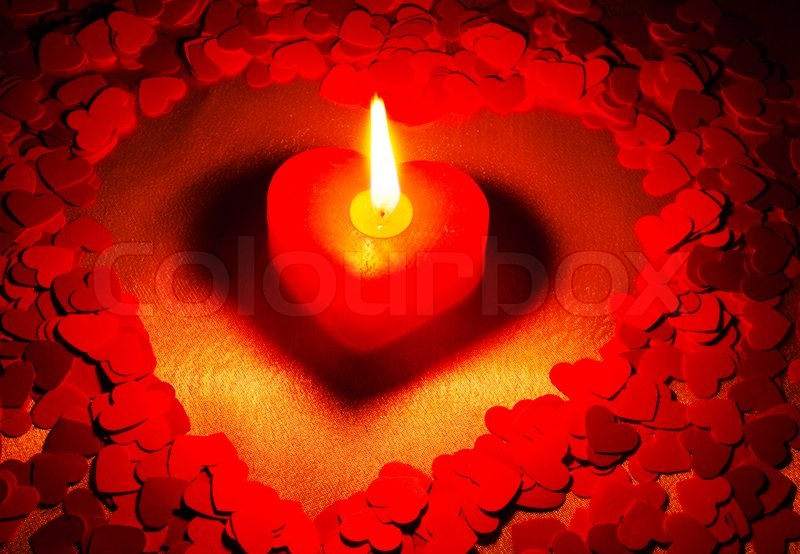 Burning Heart Shaped Candle Over Red Background Stock