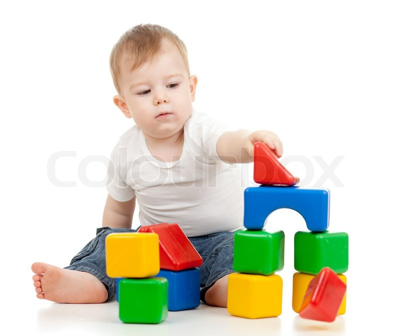 Little boy playing with building blocks | Stock Photo | Colourbox