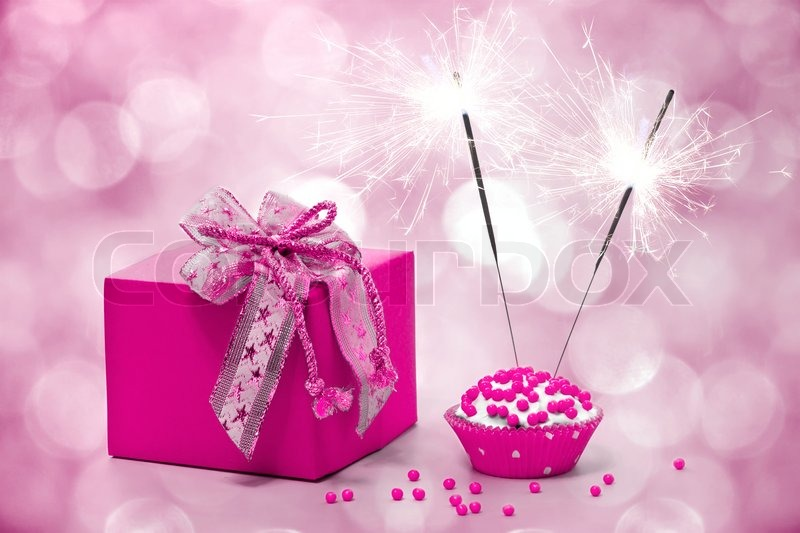 Birthday Cake With Sparkler And Gift On A Pink Background
