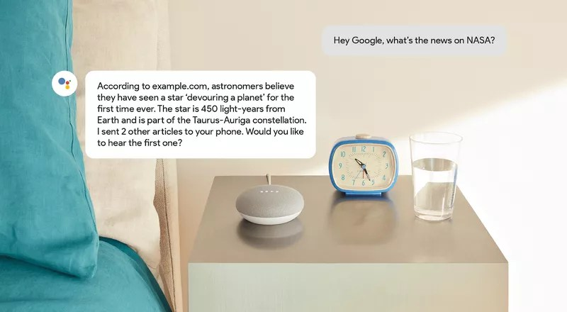 Google assistant, a clock, a glass of water,