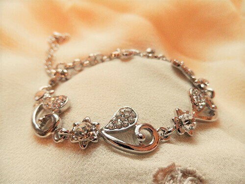 Hearts + flowers tennis-style bracelet