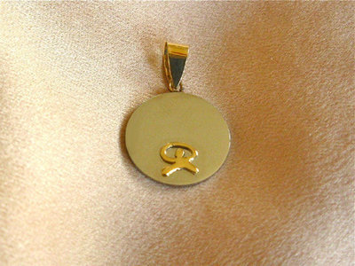 Indalo pendant ~  stainless steel disc + 18ct gold