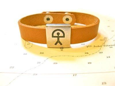 Indalo charm bracelet ~  leather strap, natural