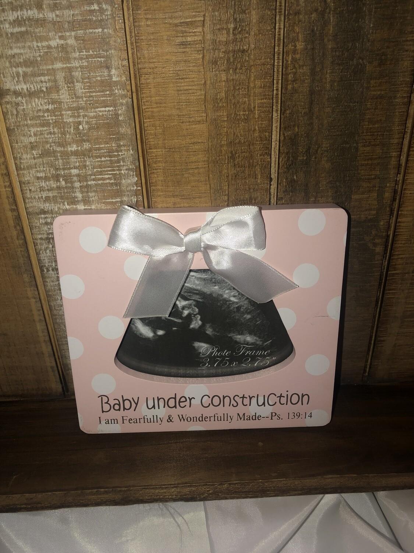 Baby Girl Under Construction Frame