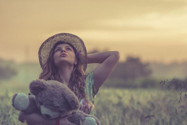 people girl woman teddy bear toy hat outdoor blur