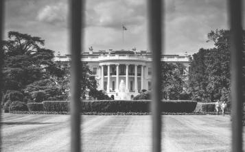 White House Washington USA United States american flag building architecture gates yard government black and white