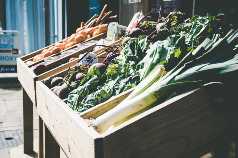 food eat sell vegetables veggies harvest grocery market cartons wood pallets street bokeh