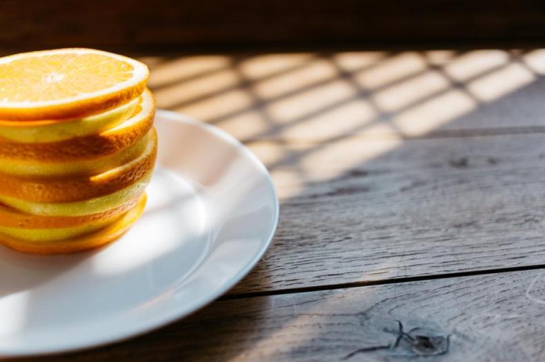 plate orange lemon fruit citrus juicy food wooden table