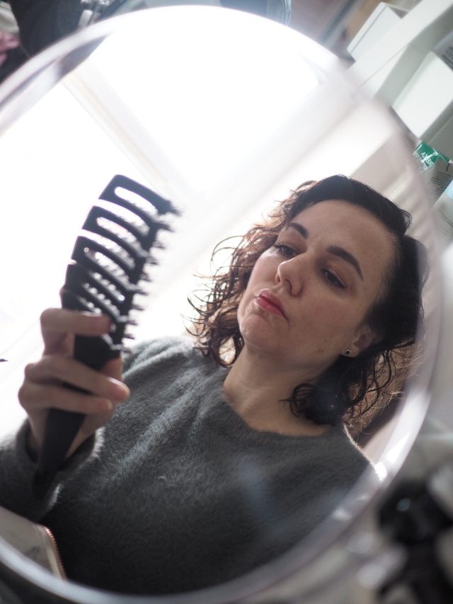Hair loss- woman looking in mirror