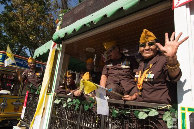 Veterans ride on bus in parade