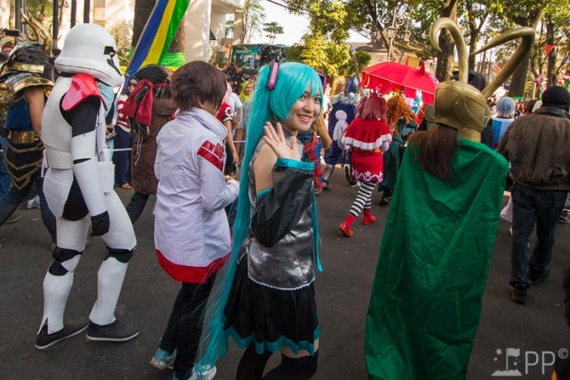 Cosplayers in parade featuring Marvel's Loki and a stormtrooper among others