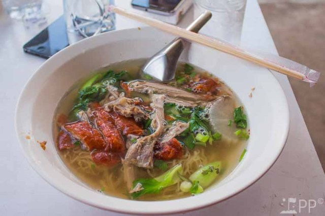 Soup of broth, fresh cut meat, and vegetables.