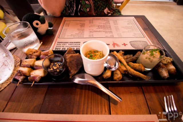 Fried fish, meats, and sauces on small platter