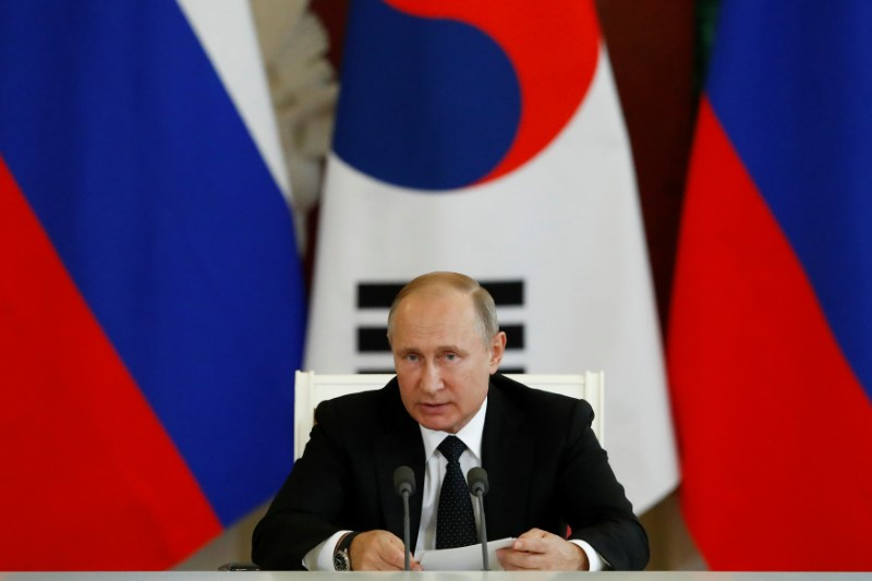 Russian President Putin speaks during a joint news conference with South Korean President Moon following the talks in Moscow