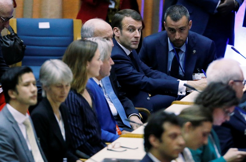 French President Emmanuel Macron sits among delegates at the United Nations Environment Assembly in Gigiri within Nairobi
