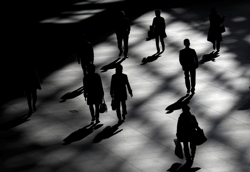 FILE PHOTO: People walk inside a building in Tokyo
