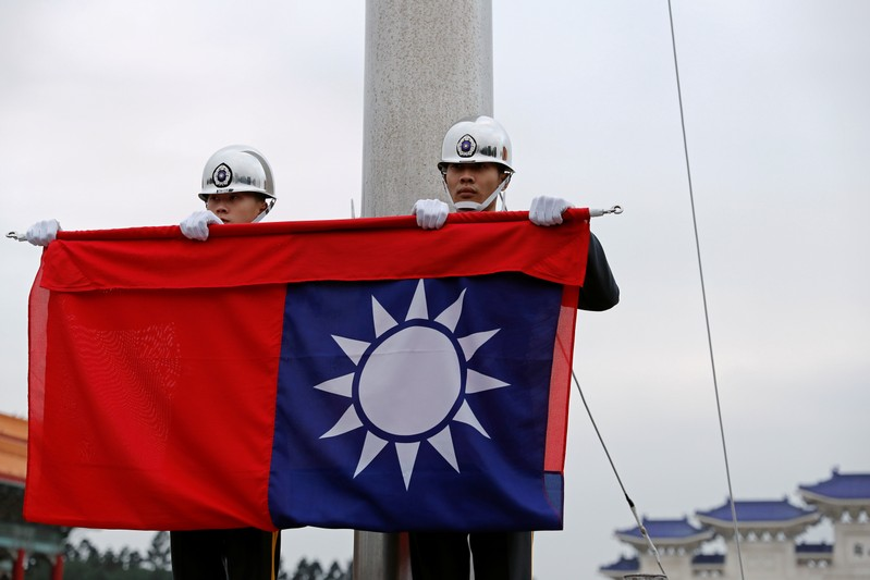 Military honour guards attend a flag-lowering ceremony at Chiang Kai-shek Memorial Hall in Taipei