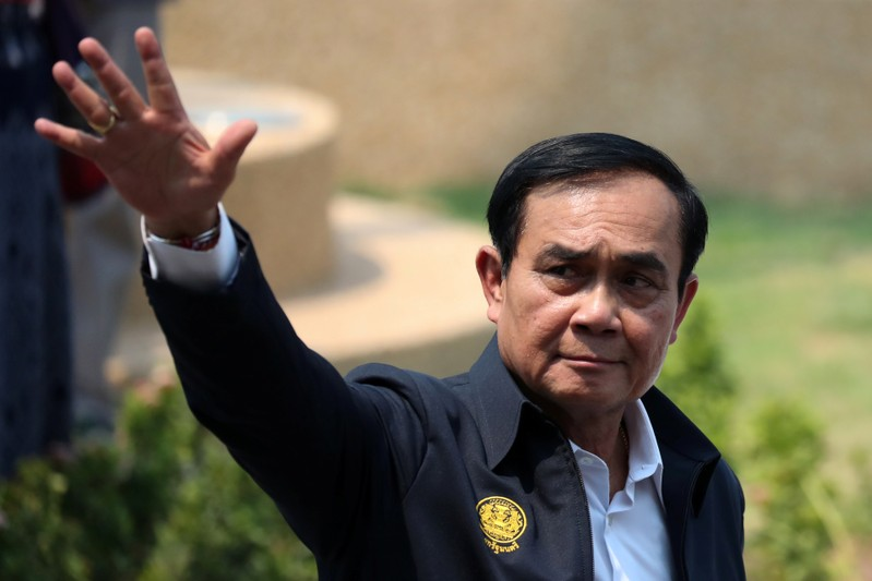 Thailand's Prime Minister Prayuth Chan-ocha gestures as he leaves Khon Kaen railway station after a visit ahead of the general election in Khon Kaen Province